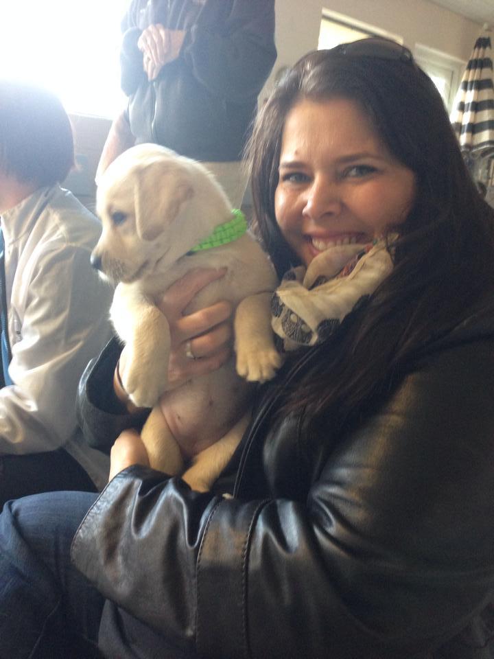 GR puppy hugging